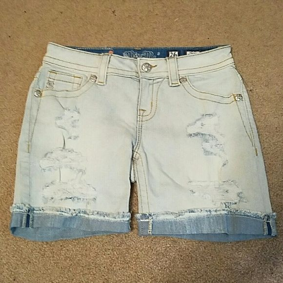 NWOT Miss Me Mid-Rise/Short Size 26 Distressed These distressed shorts are soooo cute!! They are a plain sophisticated short with a distressed front. They have the plastic still on them but the tags were ripped off. Comment any questions and feel free to leave an offer:) Miss Me Shorts Jean Shorts