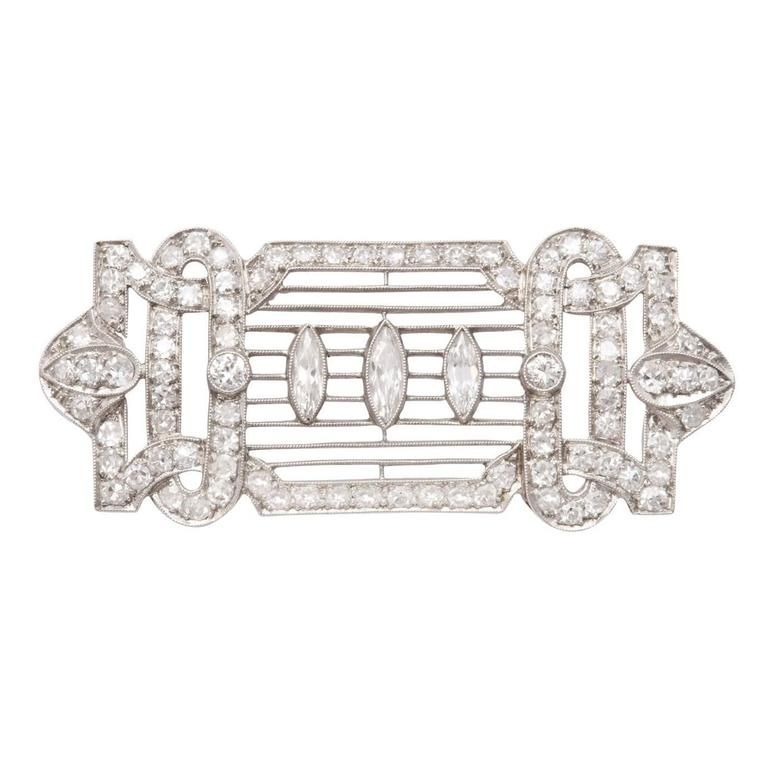 Art Deco Diamond Brooch   From a unique collection of vintage brooches at https://www.1stdibs.com/jewelry/brooches/brooches/