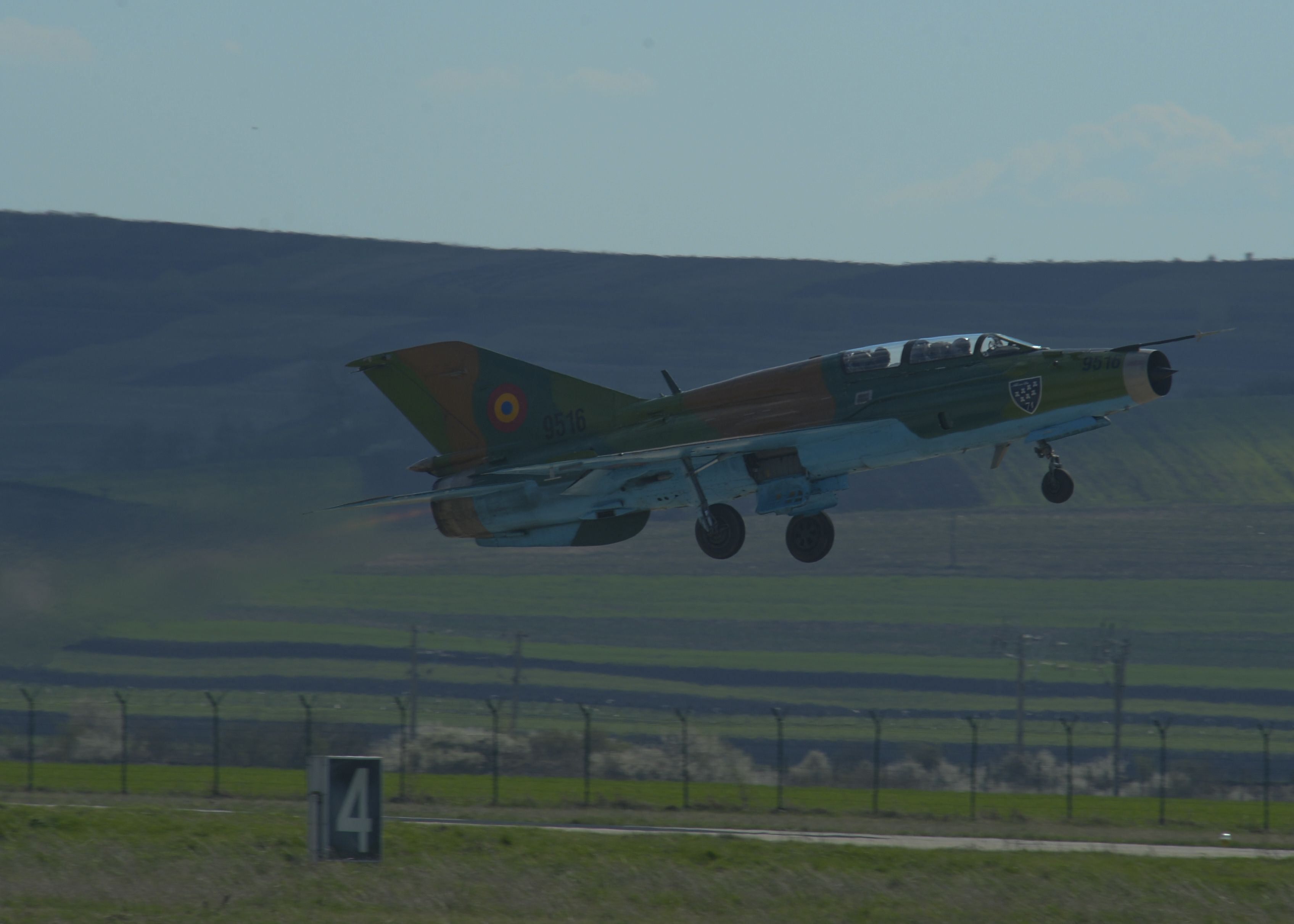 A Romanian air force MiG-21 fighter aircraft assigned to the 71st Air Base takes off from the flightline at Campia Turzii, Romania, April 16, 2015. The U.S. and Romanian air forces will conduct training aimed to strengthen interoperability and demonstrate the countries' shared commitment to the security and stability of Europe. (U.S. Air Force photo by Staff Sgt. Joe W. McFadden/Released)