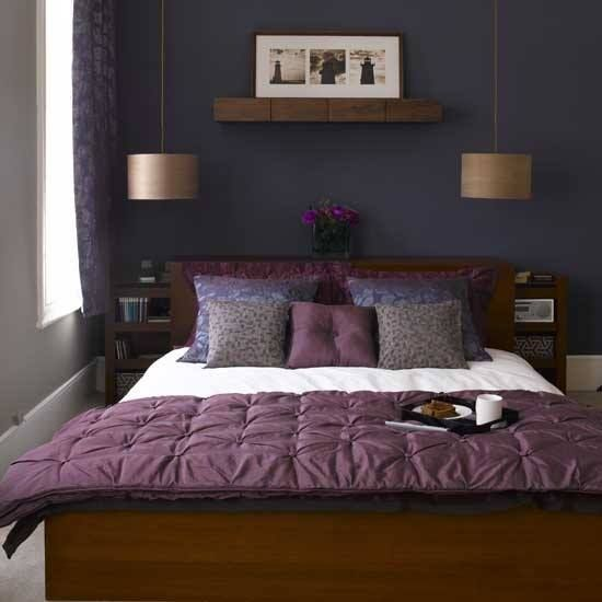 dark blue/purple walls, dark wood furniture, purple soft ...