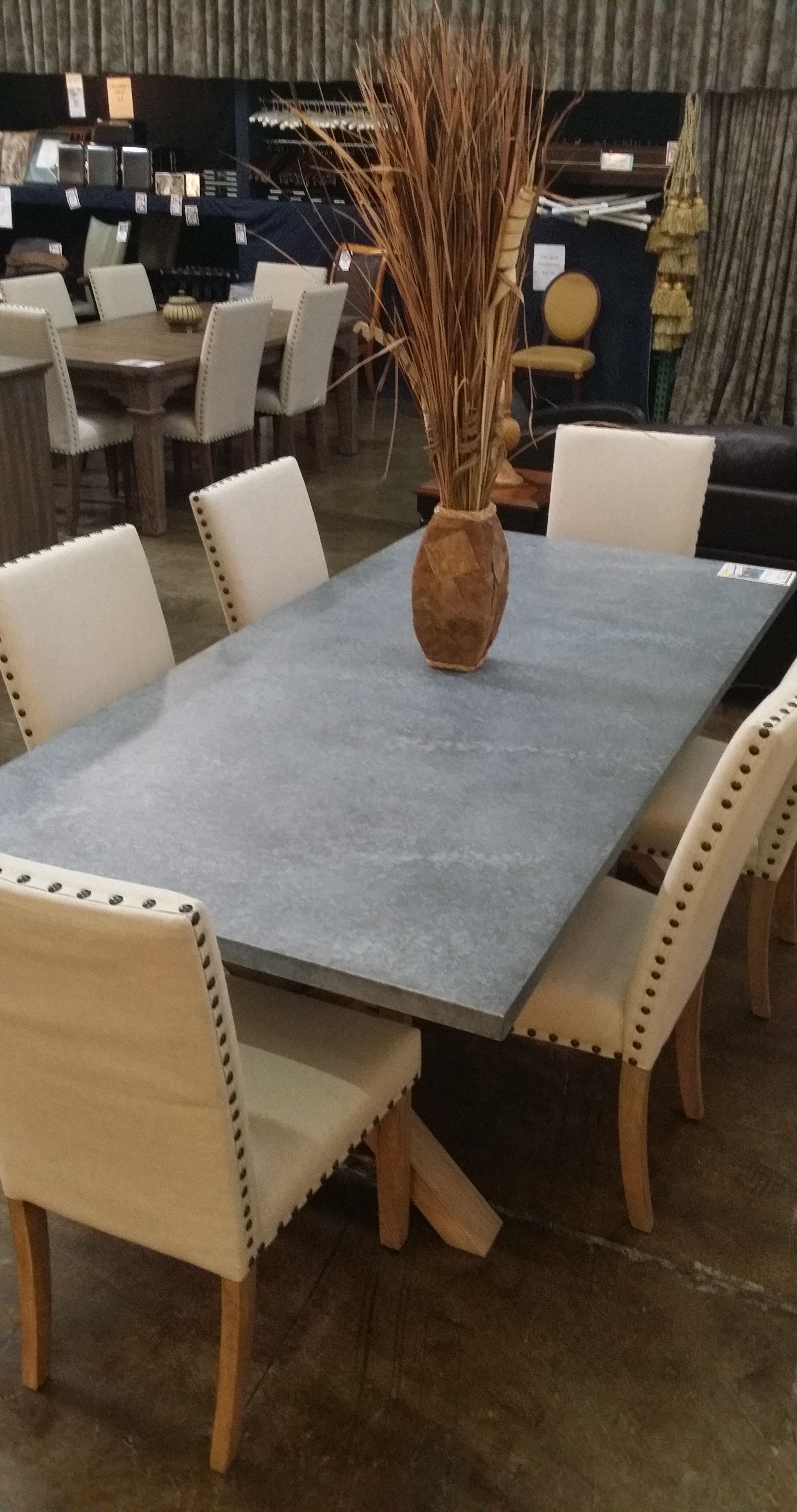 Two different styles of dining room tables with these