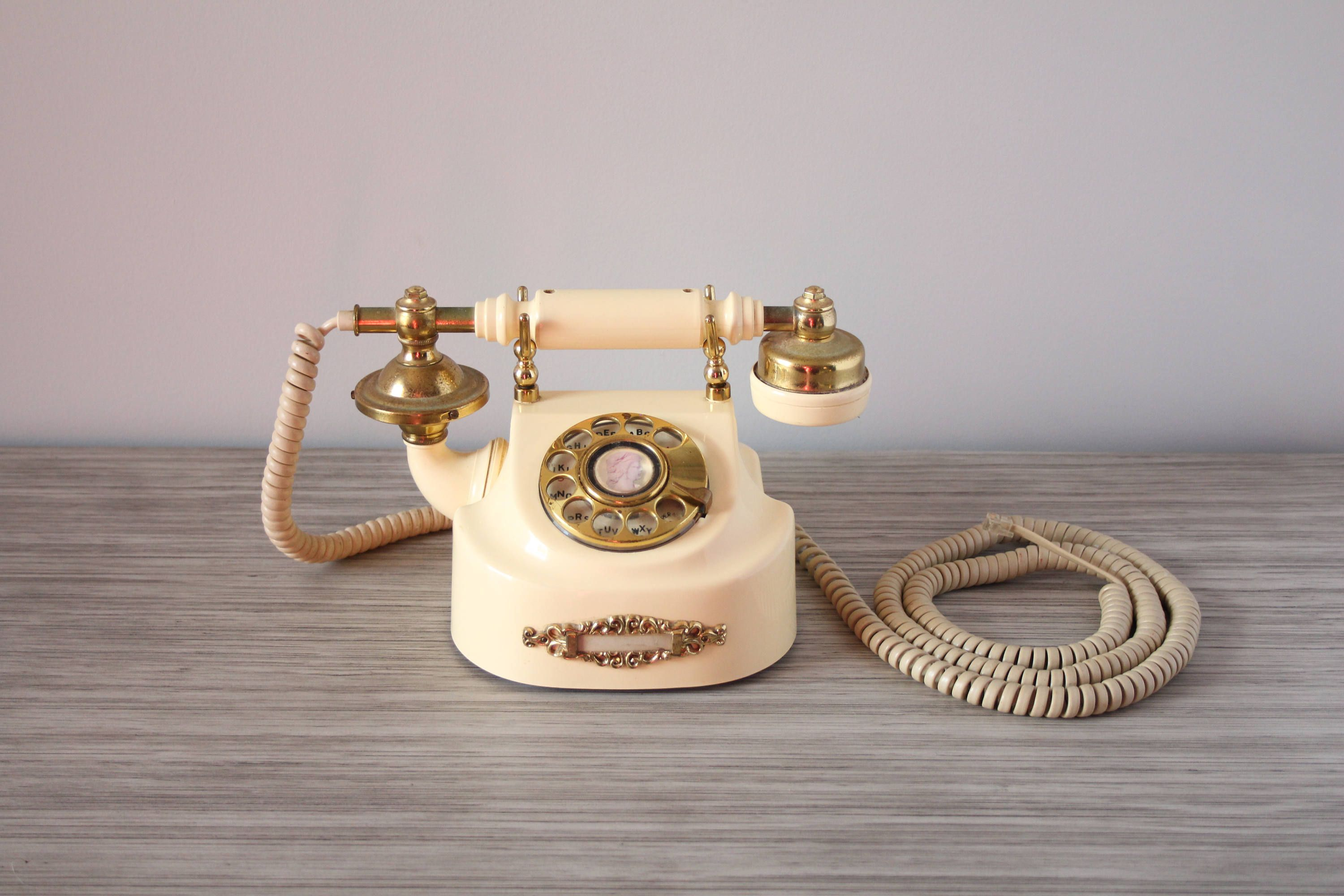 vintage french style working rotary phone solid brass hardware ivory plastic body new york telephone company photography store display prop by  [ 3000 x 2000 Pixel ]