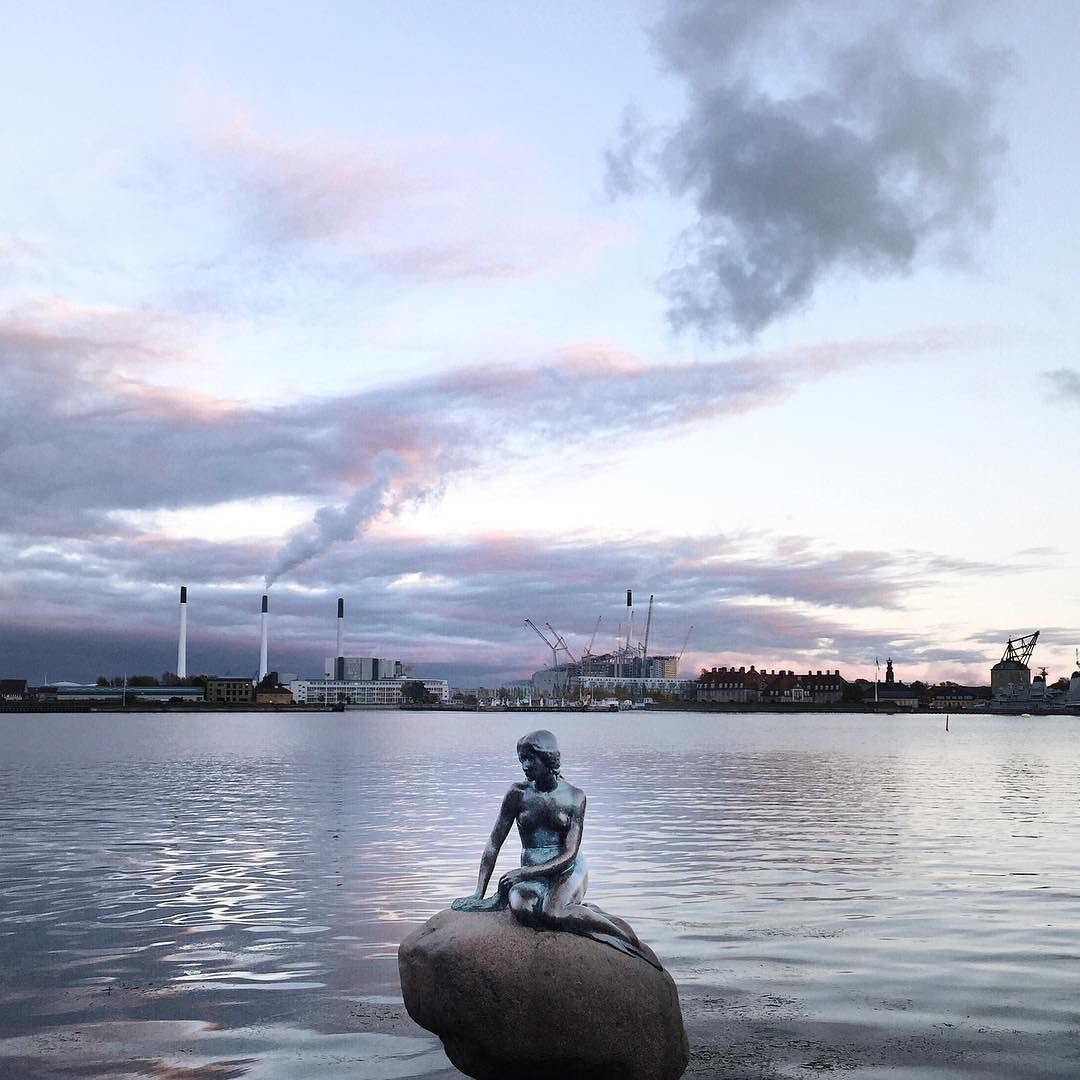 A mermaid waiting for the world to self destruct. And cloud making machines in the backdrop! Copenhagen Denmark. by hellolemun