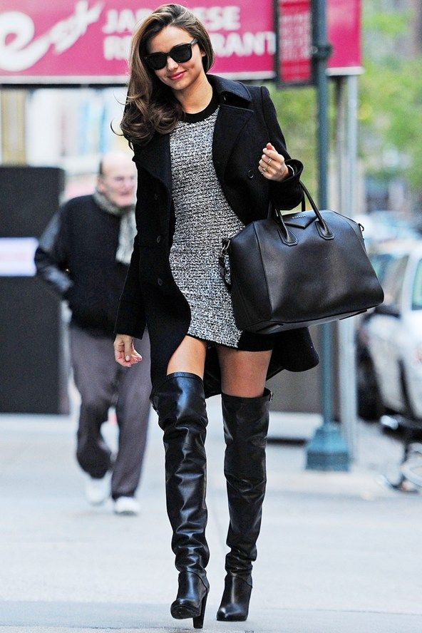 Miranda Kerr in a short dress, black coat and over-the-knee boots while out in New York.