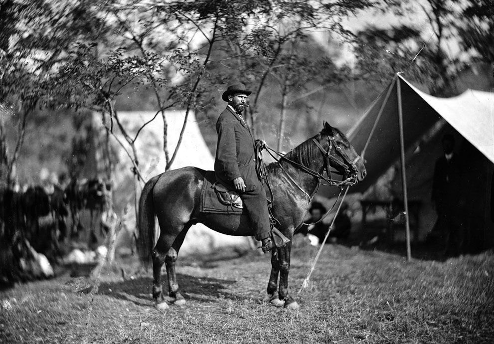 This September 1862 photo shows Allan Pinkerton on horseback during the Battle of Antietam, near Sharpsburg, Maryland. Before the outbreak of war, he had founded the Pinkerton National Detective Agency