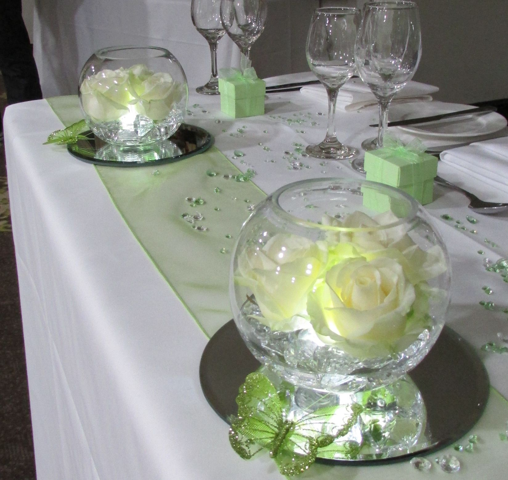 Fresh Rose In Lighted Goldfish Bowls And Green Butterflies For The Top Table .