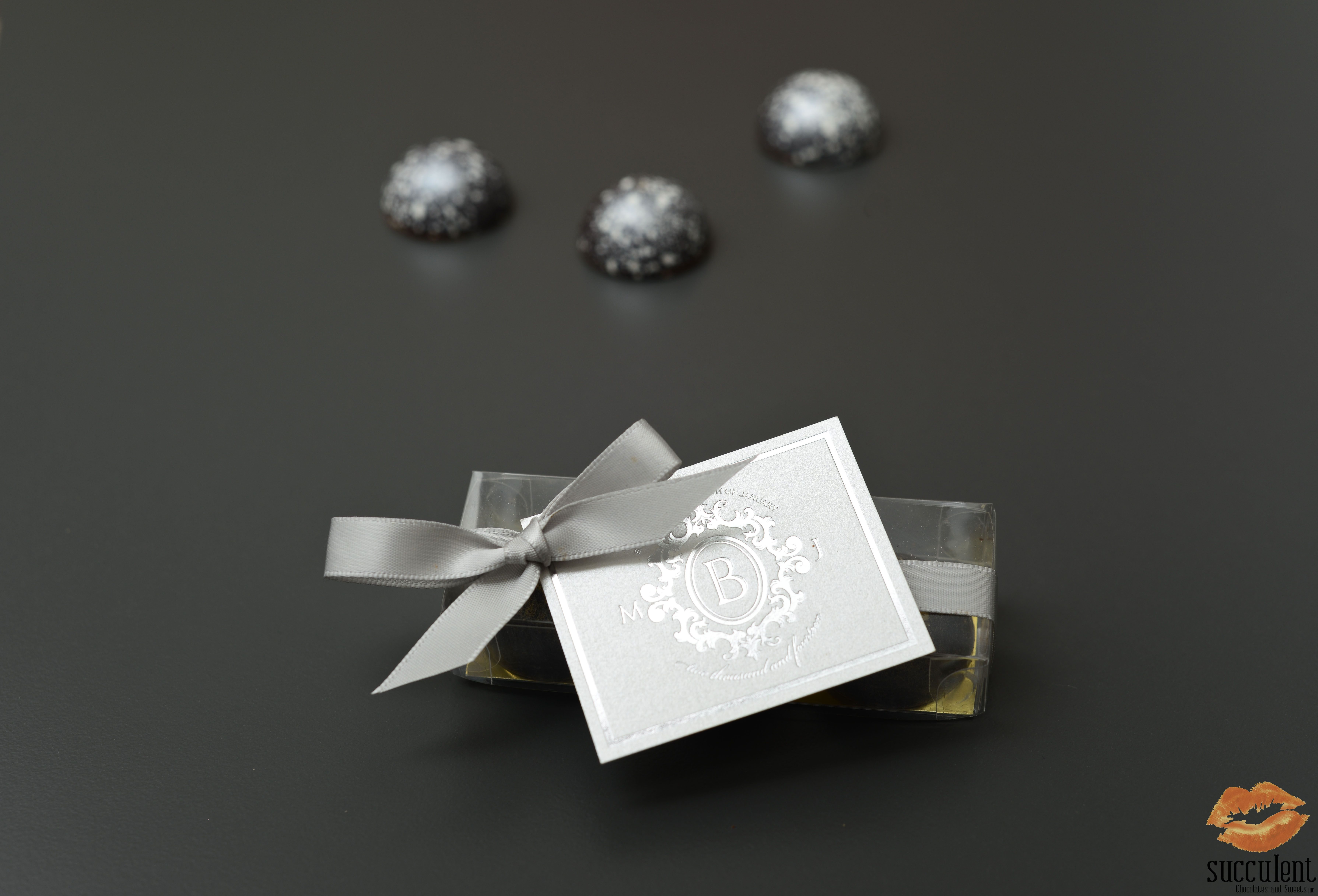 Our signature chocolate bonbons in a box of three for