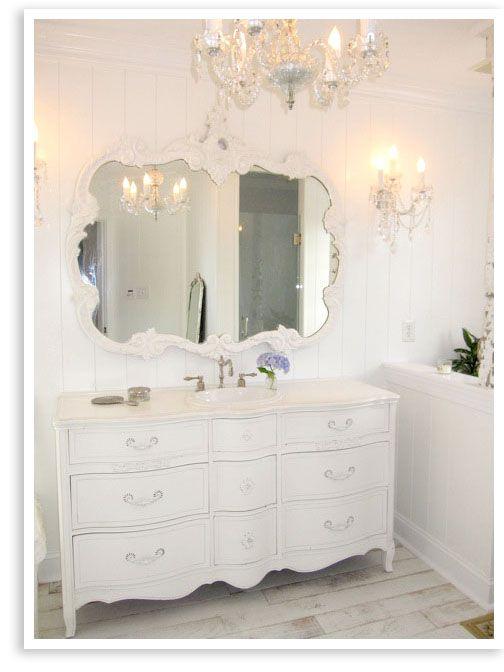#bathroom #white #dresser #sink #mirror #chandelier