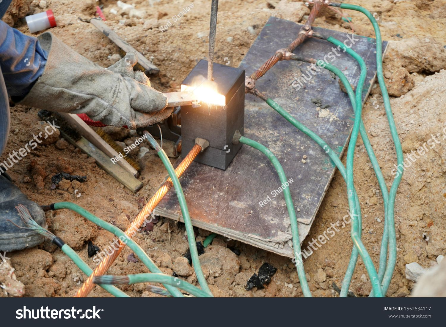Workers Are Working Connect Copper Grounding Or Ground Wire