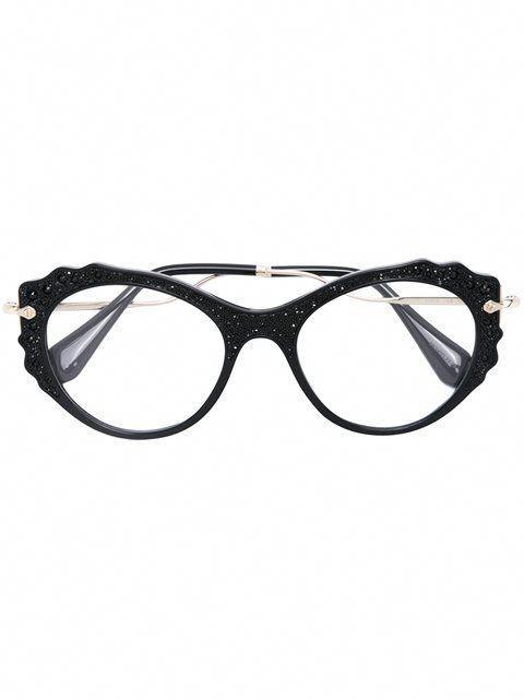 2ab67d98dde5 Shop Miu Miu Eyewear cat eye glasses.  MiuMiu