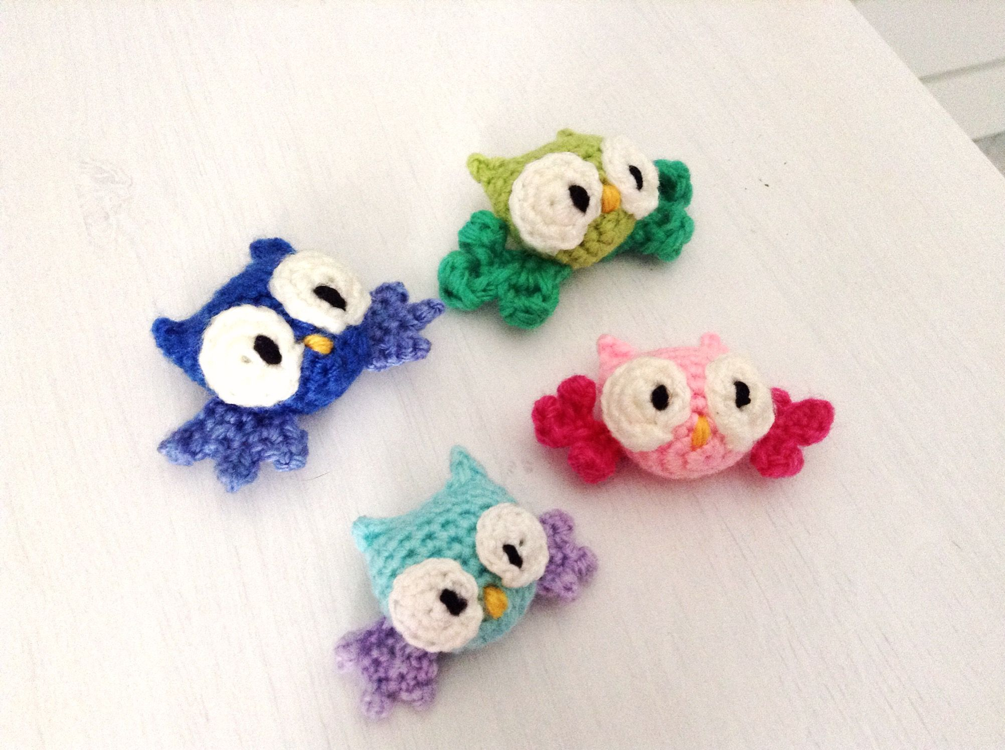 Today I thought I'd share another free pattern - of these miniature amigurumi owls! They are easy to make and can be done in a million varieties of colors and looks. I'm sharing the pattern for the...