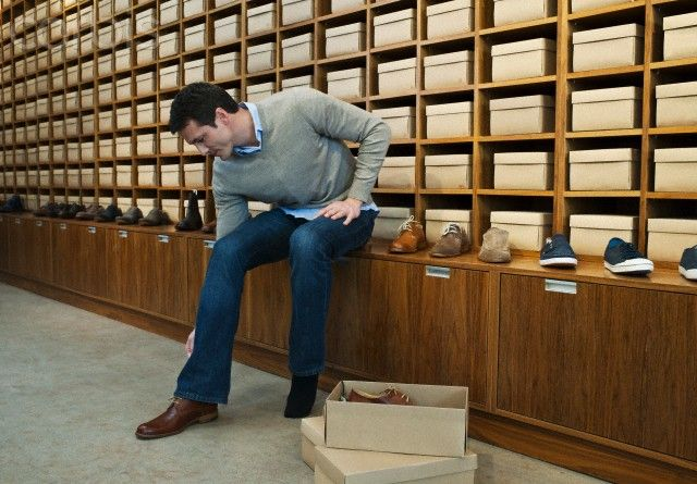 Image result for man trying on shoes