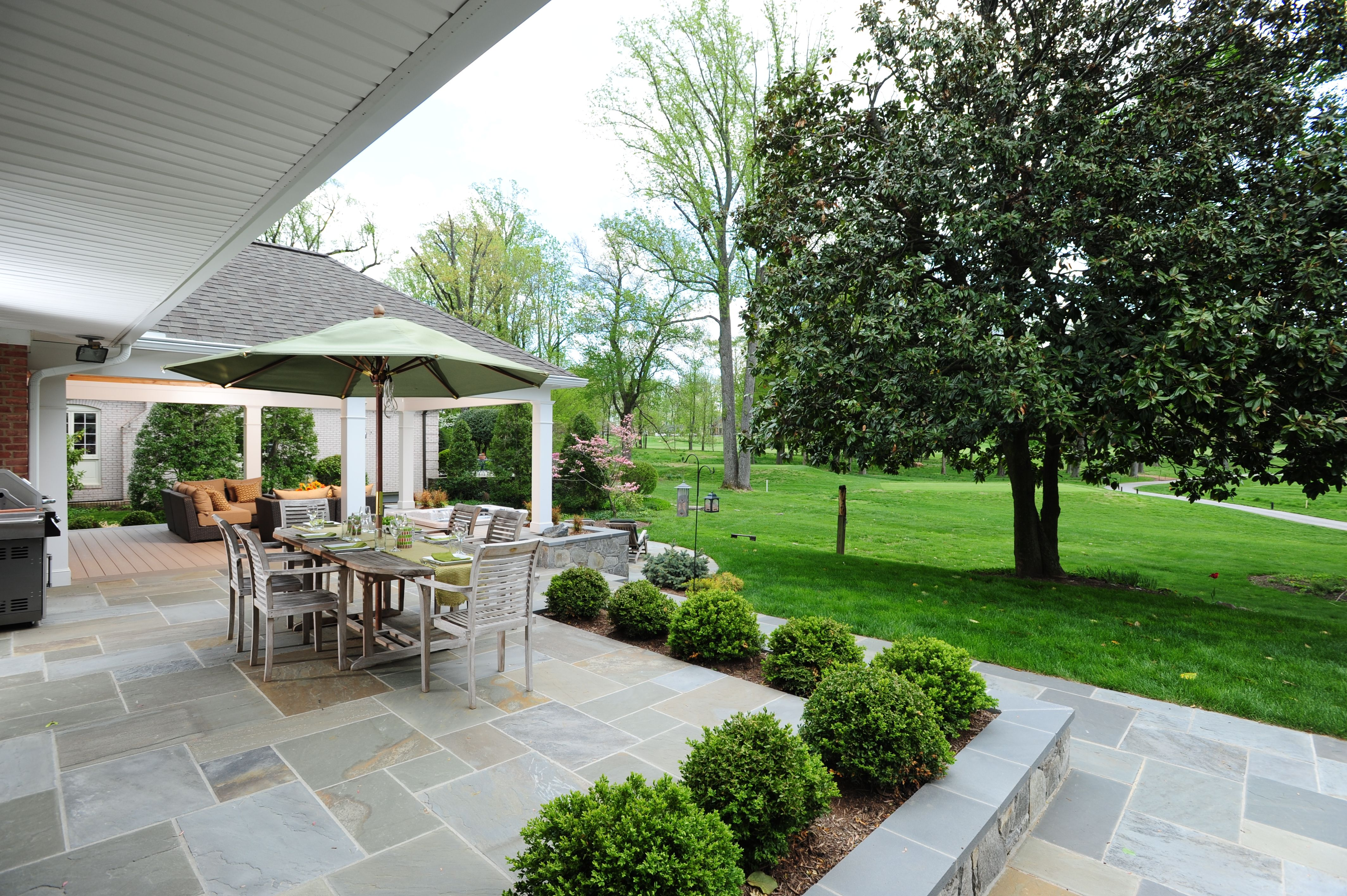 a multi level flagstone patio featuring built in plant beds