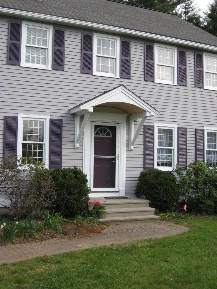 Simple overhang canopy awning hood over front door for Front door overhang ideas
