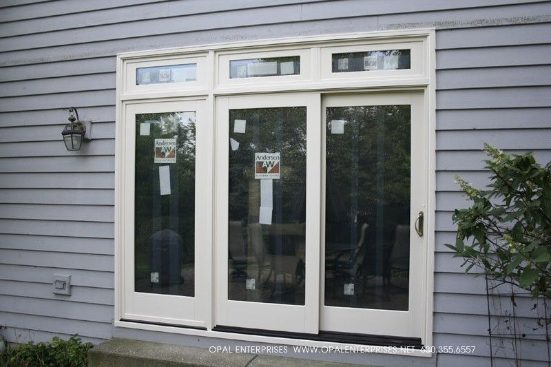 Triple Patio Door Installed By Opal Enterprises. Lovely Transom Windows  Above The Doors!