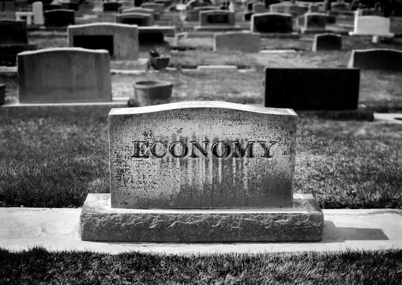 Death of the Economy. Graveyard and headstone or grave stone with economy carved ,