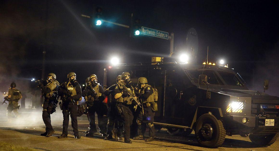 In Missouri, Ferguson Is Still Burning Military gear