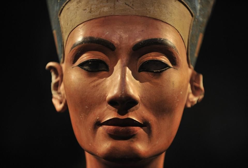 A 3,300-year-old bust of Queen Nefertiti stands on its socle, at the New Museum  in Berlin, Germany. An Egyptian official says the Antiquities Ministry gave an initial  approval for the use of non-invasive radar to verify a theory that Queen Nefertiti's  crypt may be hidden behind King Tutankhamun's 3,300-year-old tomb  in the famous Valley of the Kings [Credit: AFP/John MacDougall]