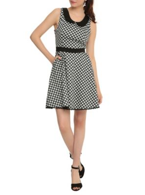 """Available 4/13 Swing dress with gingham print with revolver and glue guns, black waistband and peter pan collar. Back zipper and button closure. 35"""" long from shoulder 97% cotton; 3% spandex Wash cold; dry low Imported"""