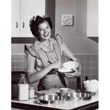 Portrait of a mid adult woman preparing food Canvas Art - (18 x 24)