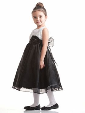 ac3a20e7721d3 Rosette Bodice with Beaded Waistband Holiday Dress. Black and white dresses  are a timeless classic