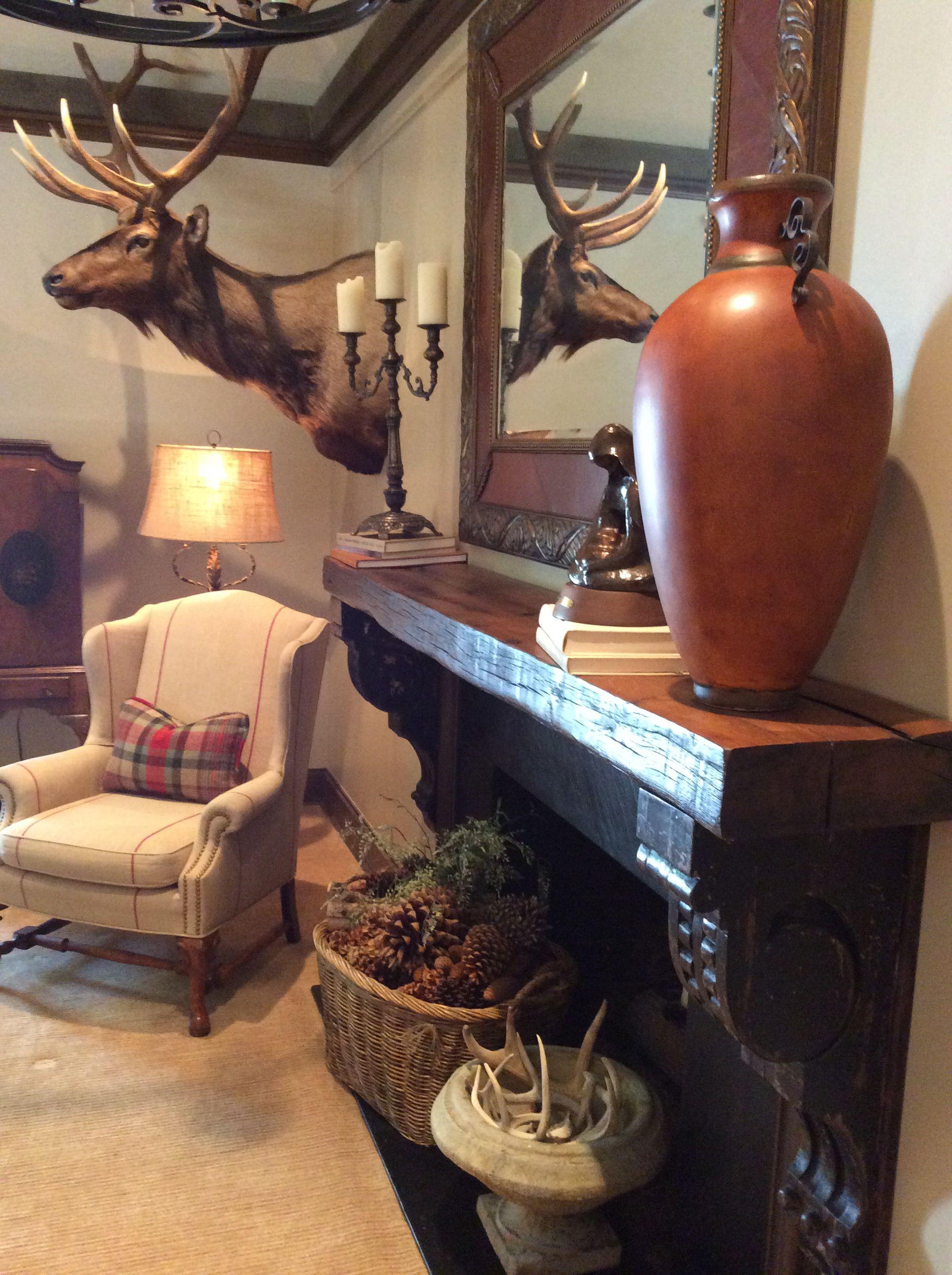 Reclaimed wood mantle and vintage corbels.