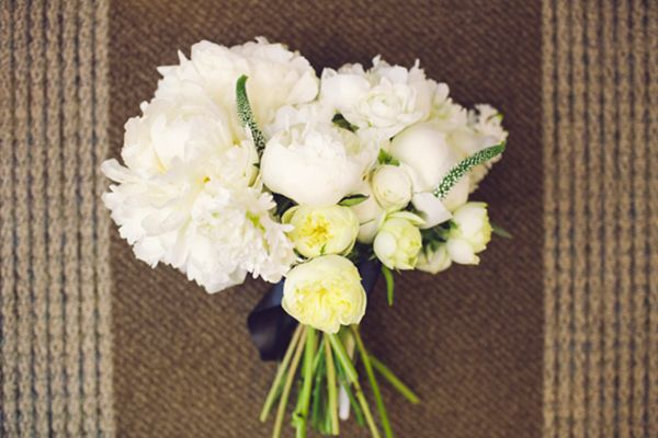 Maggie's fluffy, white, peony bouquet is totally perfect for a winter wedding, yes?