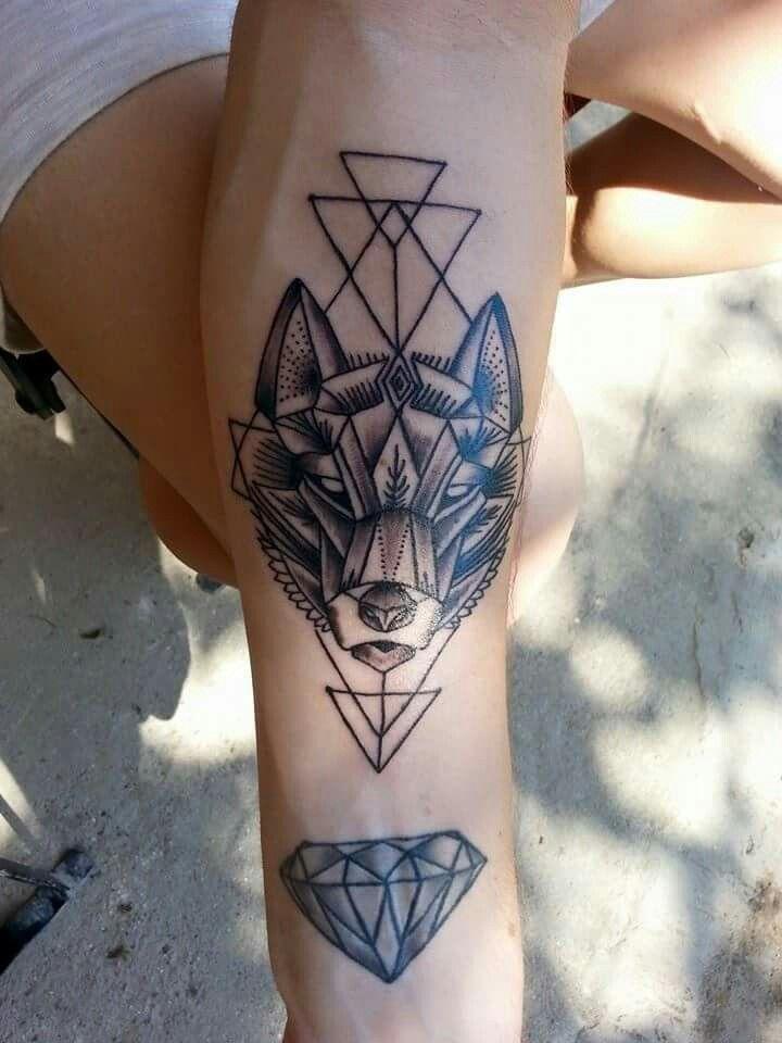 Wolf and diamond tattoo