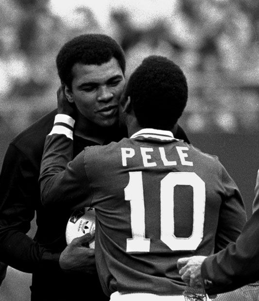 Pele is shown embracing Muhammad Ali during a ceremony honoring the Brazilian soccer star of the New York Cosmos at Giants Stadium, East Rutherford, N.J., October 1, 1977