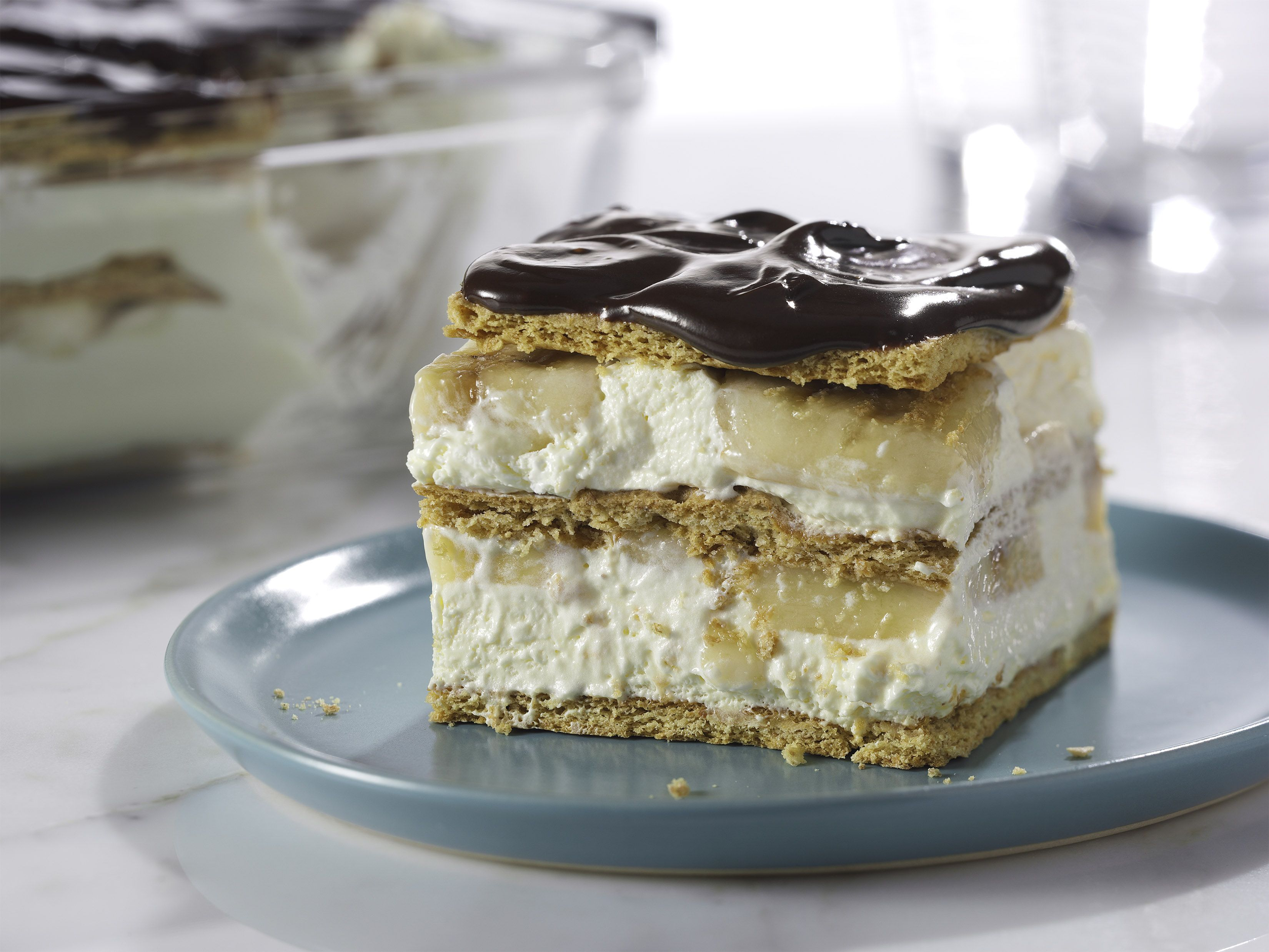 """No-Bake Banana Éclair """"Cake"""" – The hardest part of this easy dessert recipe? Waiting for it to cool in the refrigerator. Great taste and no-bake! #PinThatTwist"""