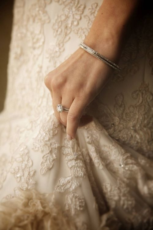 wedding ring hand holding dress Ring and dress detail in one shot