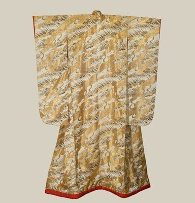 Early Showa period (1927-1940). A large silk uchikake (wedding over-kimono) featuring many woven flying cranes created with the brocade weaving technique. Originally created in Kyoto, Japan.