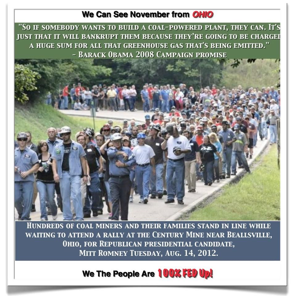 Hundreds of coal miners and their families wait in line to