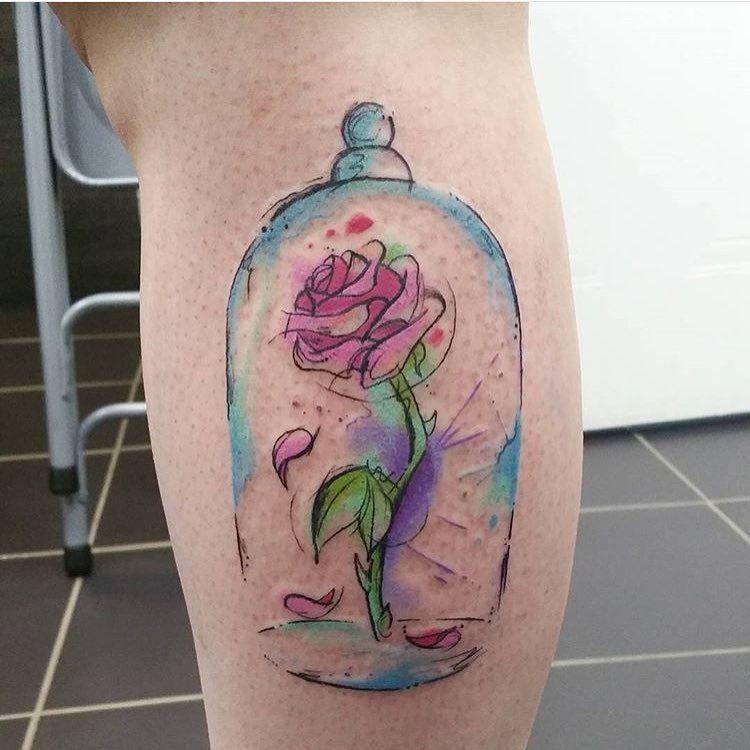 beauty and beast rose tattoo