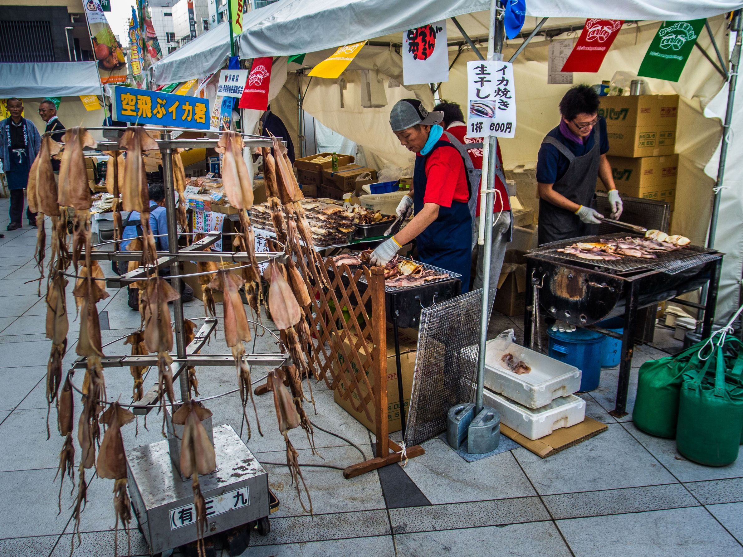 Freshly roasted ika (squid) from Aomori outside Asakusa's (and Taito Ward's) biggest library in Kappabashi -there was a festival/fair there this last weekend... #Asakusa, #Kappabashi, #Aomori, #ika, #squid October, 12 2015 © 2015 Grigoris A. Miliaresis