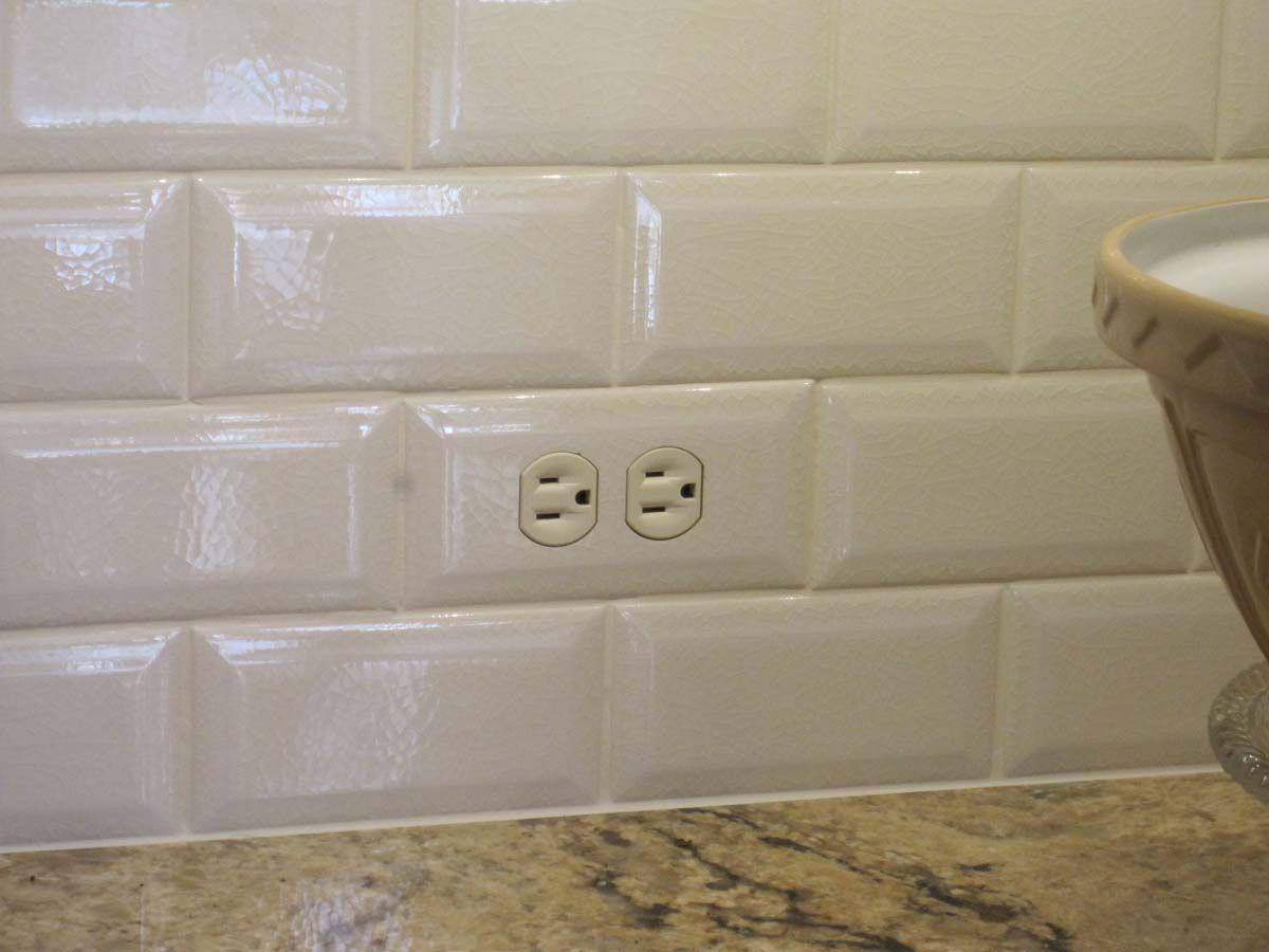 How to place outlets in subway tile close up of a tiled in close up of a tiled in subway tile switch plate cover definitely doing this to hide all the ugly outlets required by current code dailygadgetfo Image collections