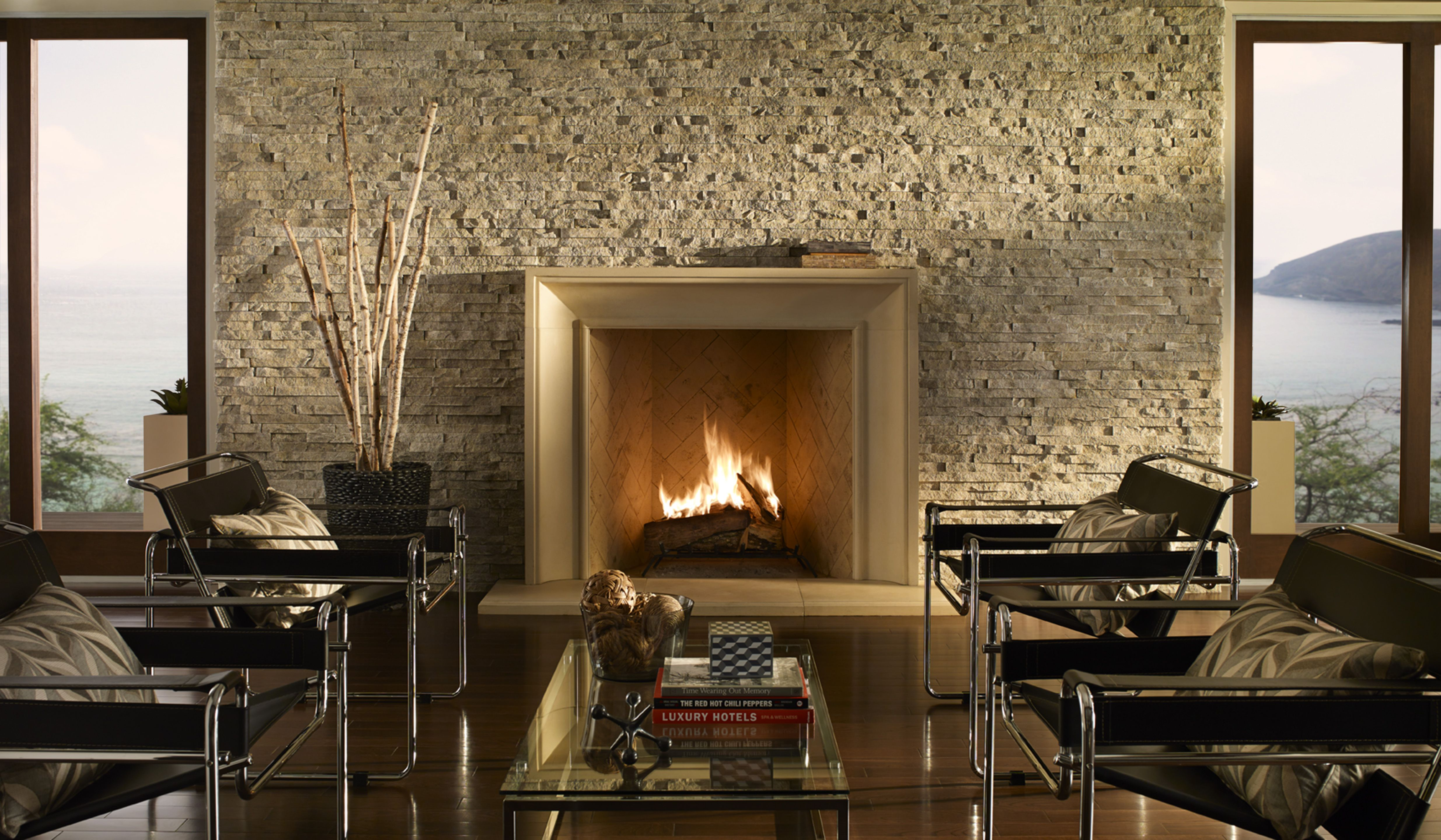 Modern living room with stone fireplace and drystack stone wall