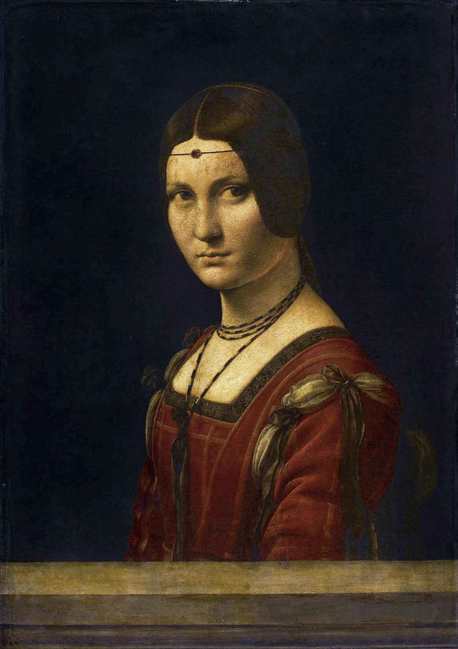 """""""Portrait of an Unknown Woman (La Belle Ferronière)"""" in 1490-95 attributed to Leonardo da Vinci (Vinci 1452-Amboise 1519). Oil on wood. Musée du Louvre. Renaissance. The model of the painting is still shrouded in mystery. The work reflects the intense optical study of the period in Milan."""