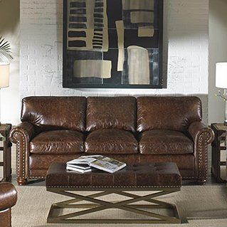 There S A Reassuring Familiarity To The Lazzaro Sofa With Its Rounded Arms And Nailhead Trim That Speak With A Britis Leather Sofa Best Leather Sofa Best Sofa