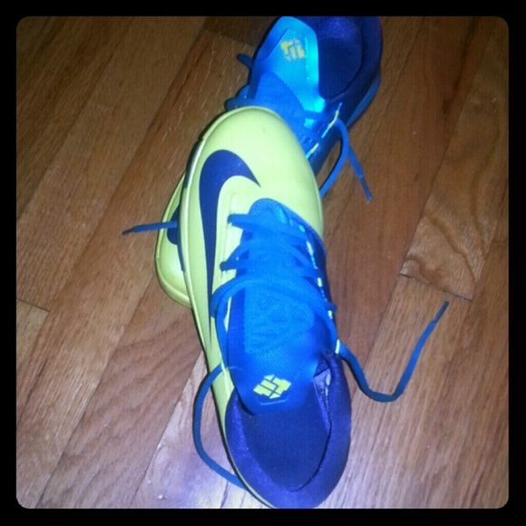 Kd's Yellow/turquoise I only wore them 5 times they're basically like new my price is very firm they're in good condition they're clean no wrinkles, no scuffs they're clean.. Nike Shoes