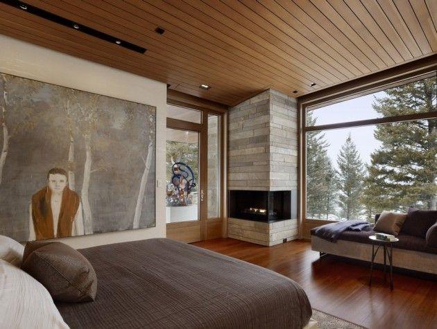 Schlafzimmer hütte eckkamin stein verkleidet panoramafenster