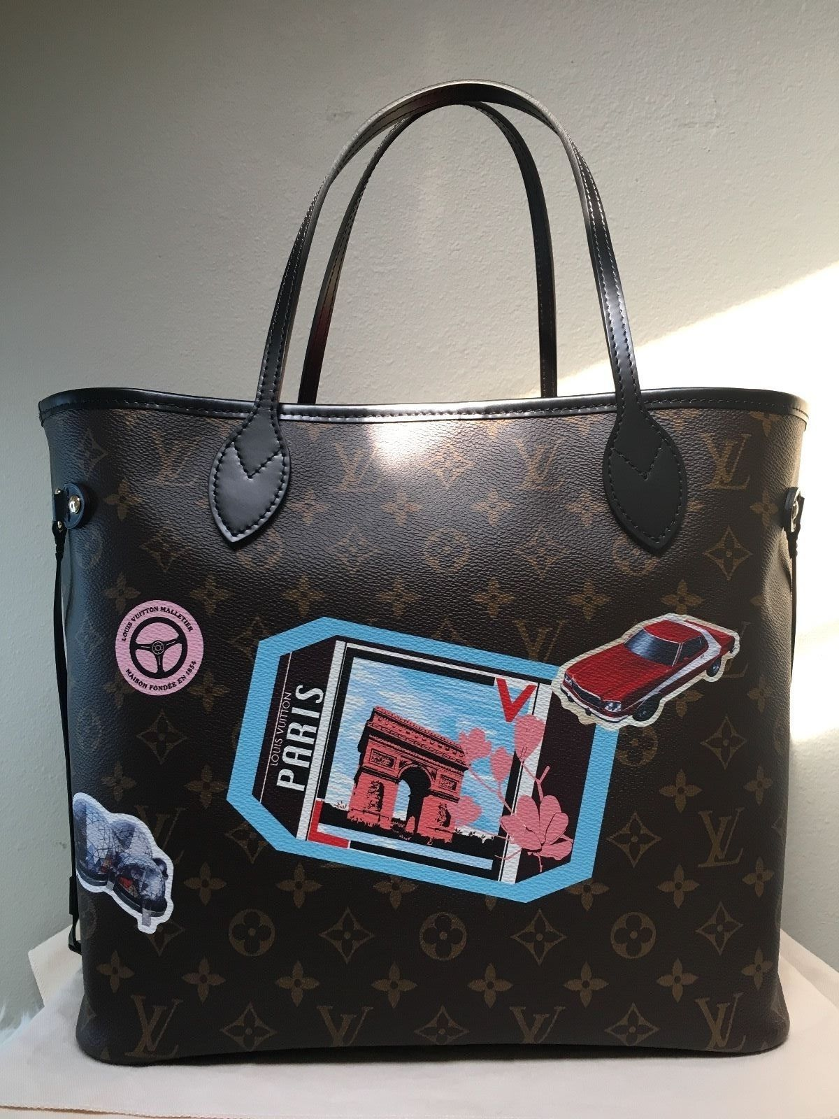 4505cb22317d Louis Vuitton Neverfull MM World Tour Limited Edition