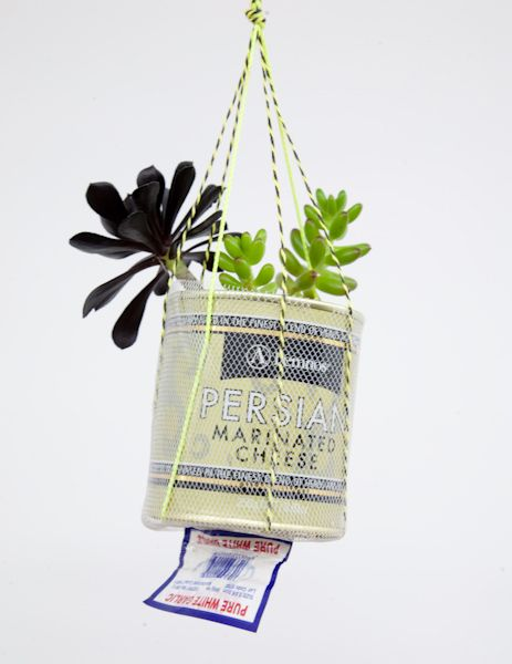 repurposed HANGING plant planters... twine, tulle, mesh, (this is from a mesh bag), big metal tin pot, like a coffee can