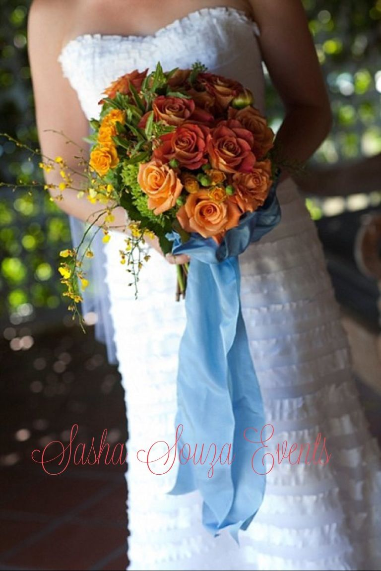 Daily Pretty:  Bright bridal bouquet with Ecuadorian roses, young hydrangea, oncidium orchids, spray roses and mum blossoms finished with French blue wires ribbon. Image by Sherman Chu