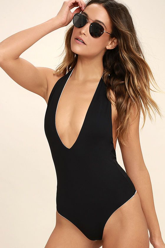 2f475ca8a0f4c Take the plunge and add the super sexy Bond-Eye Dive In Black Reversible  Halter One Piece Swimsuit to your cart! Sleek black knit falls from a  halter ...