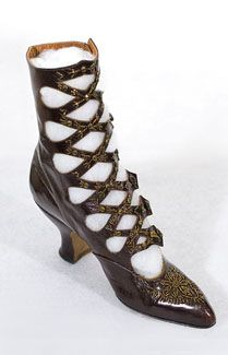 Beaded cross strap boots, c.1900-1905. Made from deep plum colored, bronzed kid leather - rare in such condition. The crisscross straps and toes are embellished with bronze metallic beads. The Louis heels, more difficult to make than straight heels, were reserved for expensive shoes and boots.