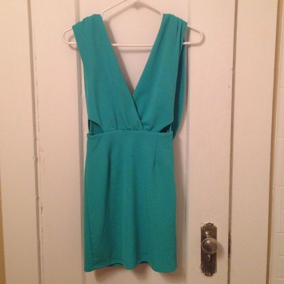 NWOT Open Back Green Cocktail Dress XS! Super cute dress, so sad to let it go but I just don't have the boobs to fill this dress. Dress is low cute, open back, and mini. Color is true to the stock photo. NWOT from Lulus Lulu's Dresses