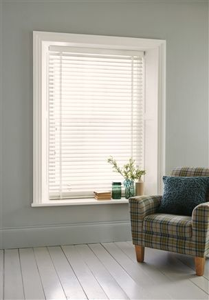 white wooden venetian blinds inset to room for window sill to be used as shelving