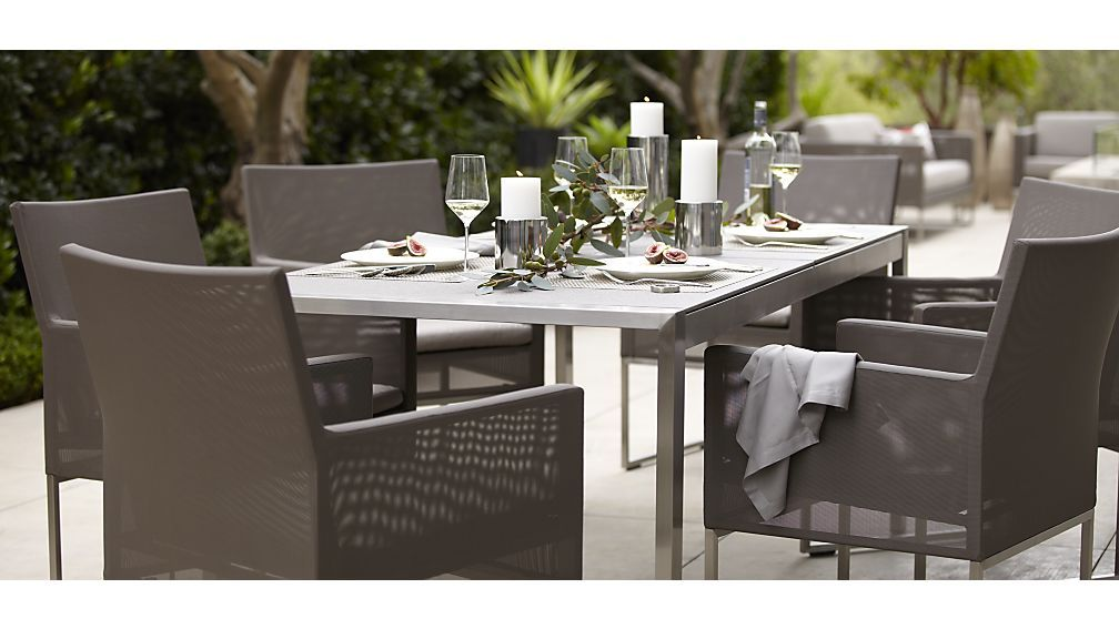 The Dune Outdoor Dining Table With Pebbled Gl Is A Crate And Barrel Exclusive 1 199 15 Grade Stainless Steel Frame 8mm Thick Substrate