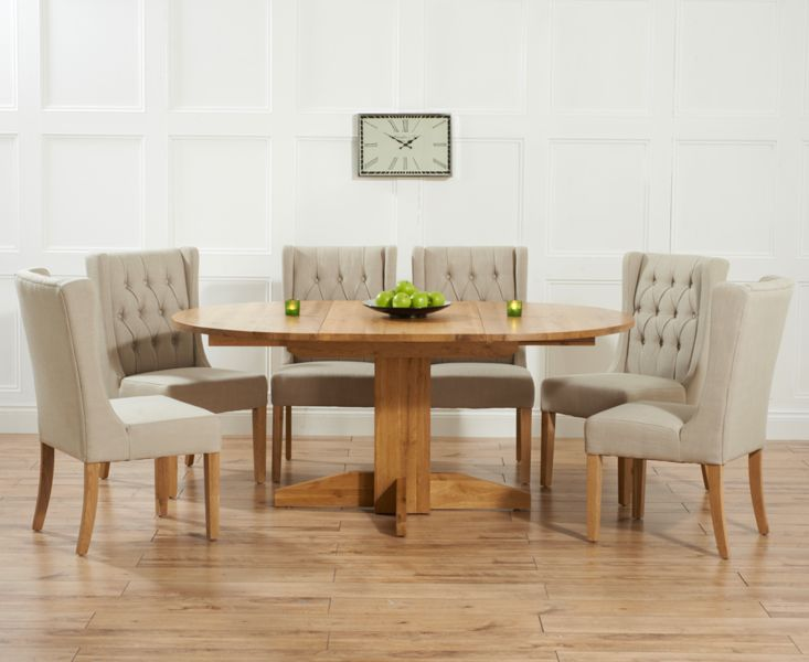 Dorchester 120cm Solid Oak Round Extending Dining Table With Safia Fabric  Chairs.